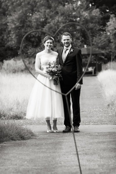 Bride and groom portrait in heart at Floral Media