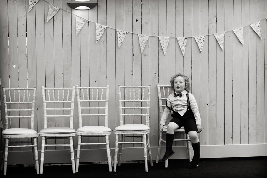 boy sitting on chairs at Floral Media wedding