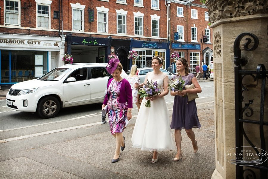 bride, bridesmaid and mum walking into The Gilstrap registry office