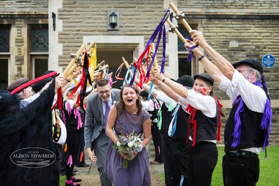 bridesmaid laughing with morris dancers