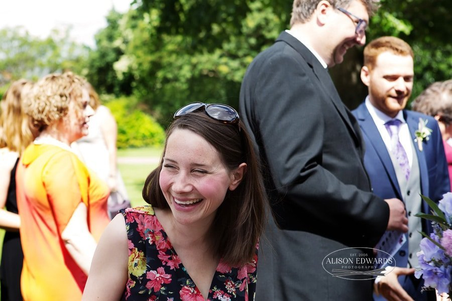guests laughing after wedding ceremony