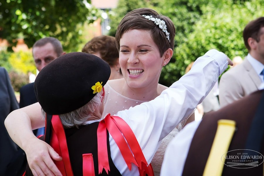 bride hugging morris dancer friend