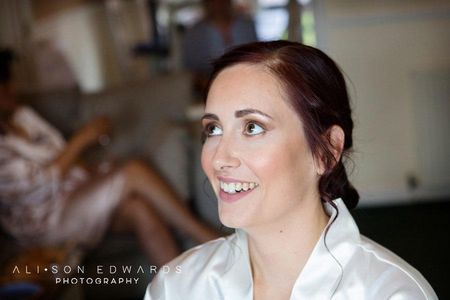 bride smiling having makeup done in Nottingham