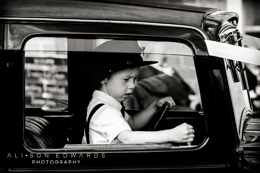 young boy in wedding car at cockcliffe country house wedding