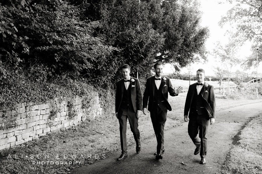 groomsmen walking to st james church papplewick