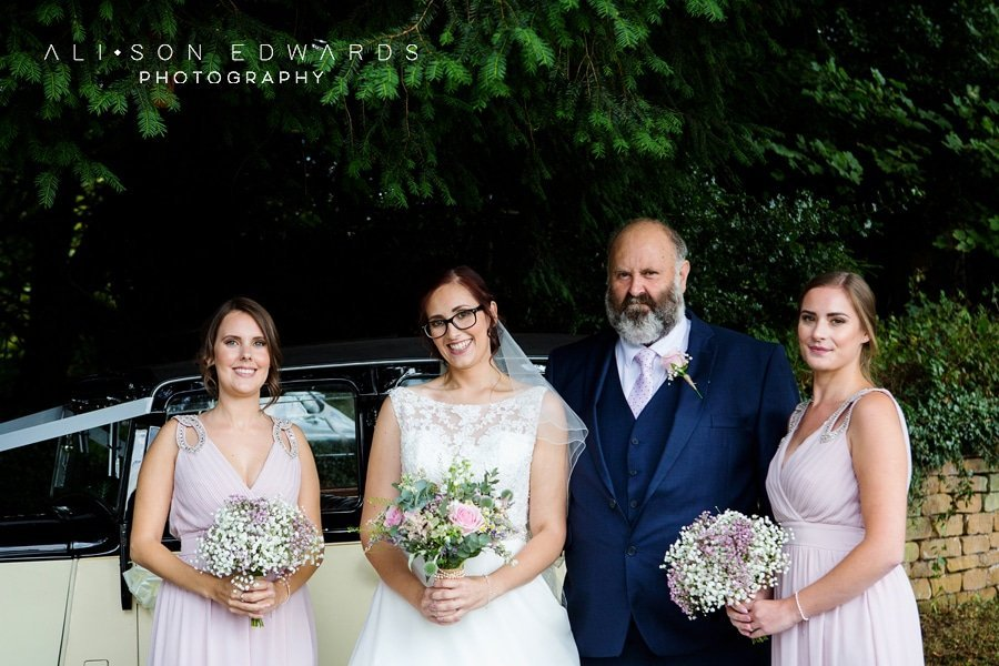 bride bridesmaids and father at st james church papplewick