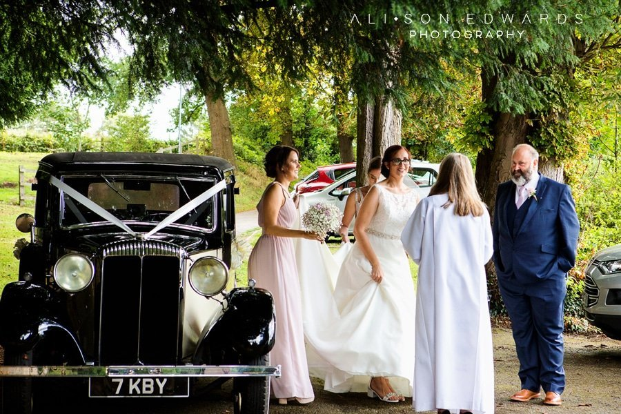bride and bridesmaids getting out of wedding car at james church papplewick