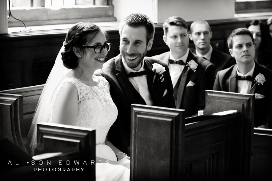 bride and groom laughing in ceremony at st james church papplewick
