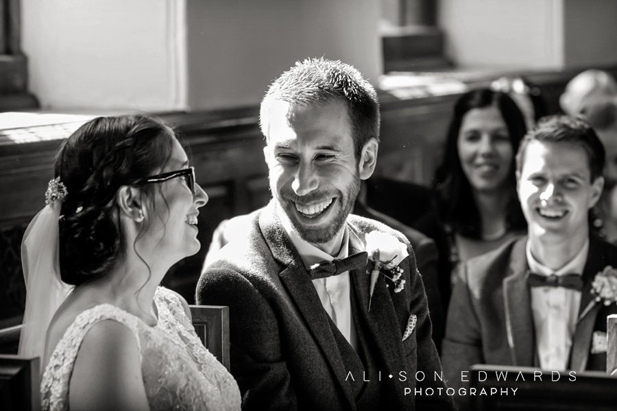 bride and groom laughing at st james church papplewick