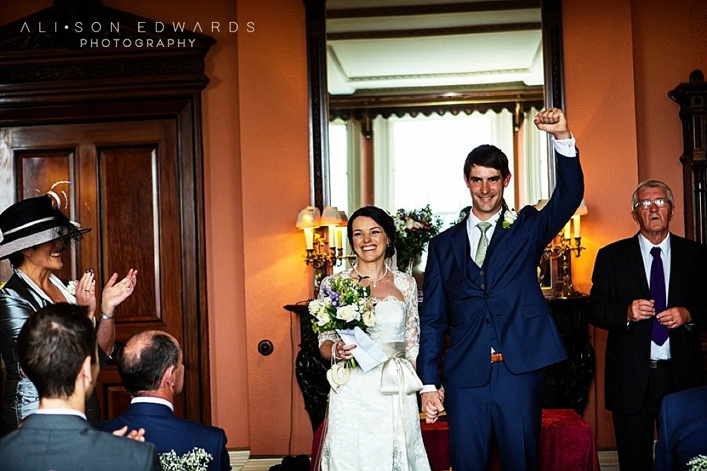 bride and groom do't like posing cheering after wedding vows