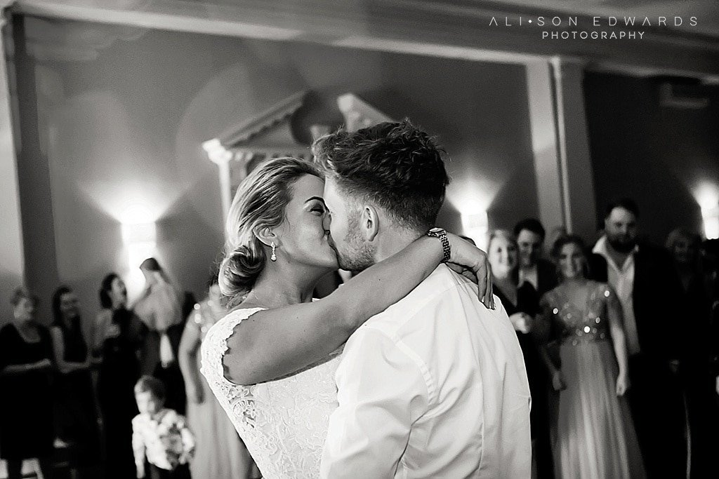 bride and groom kissing doing first dance