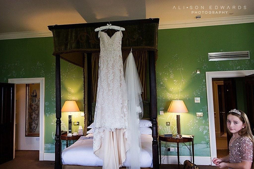 wedding dress on 4 poster bed at stubton hall