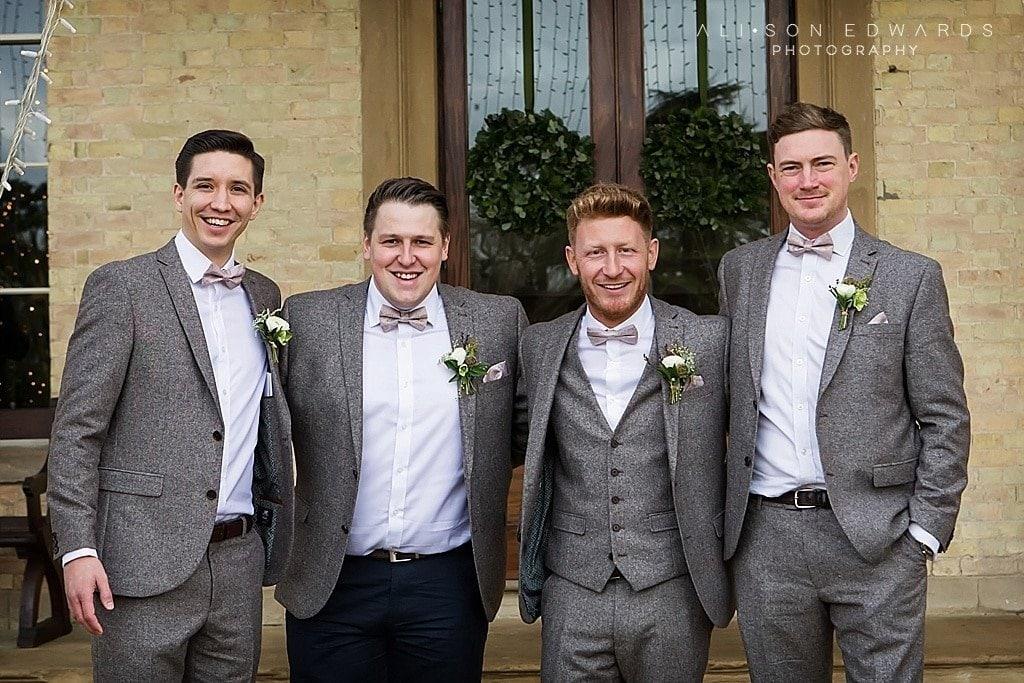 groomsmen in front of stubton hall