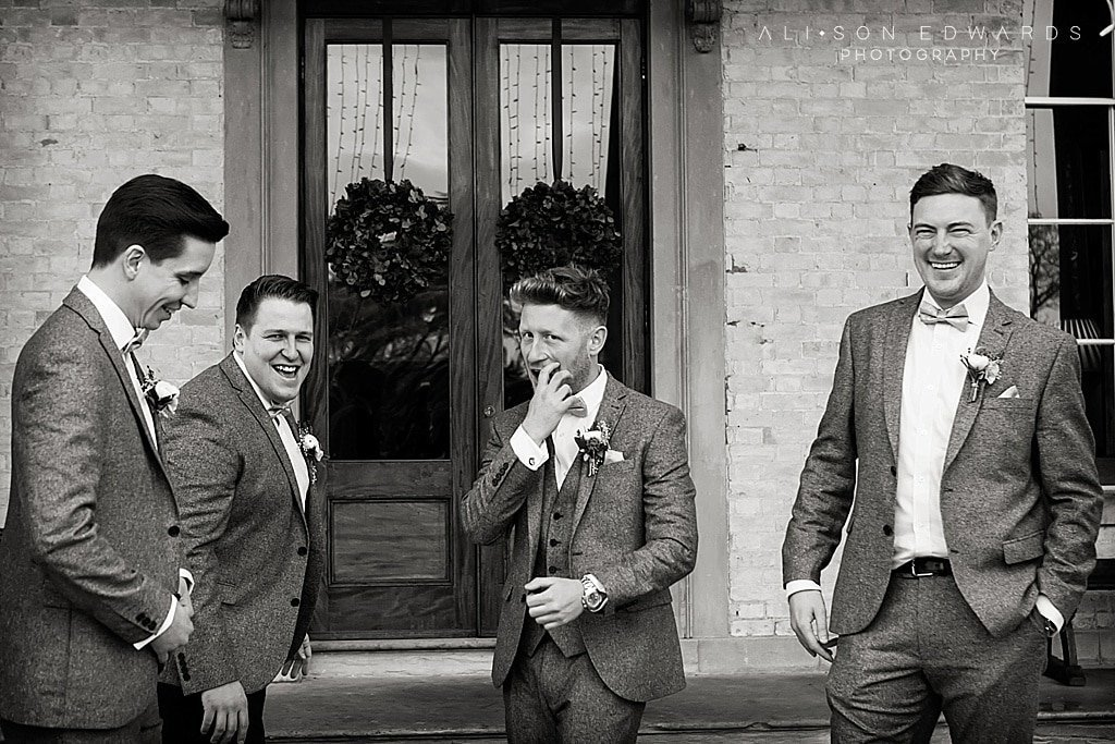 groomsmen laughing at stubton hall