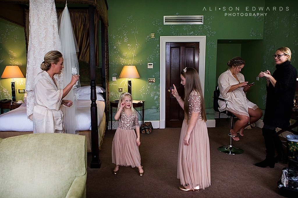 bride and bridesmaid dancing getting ready