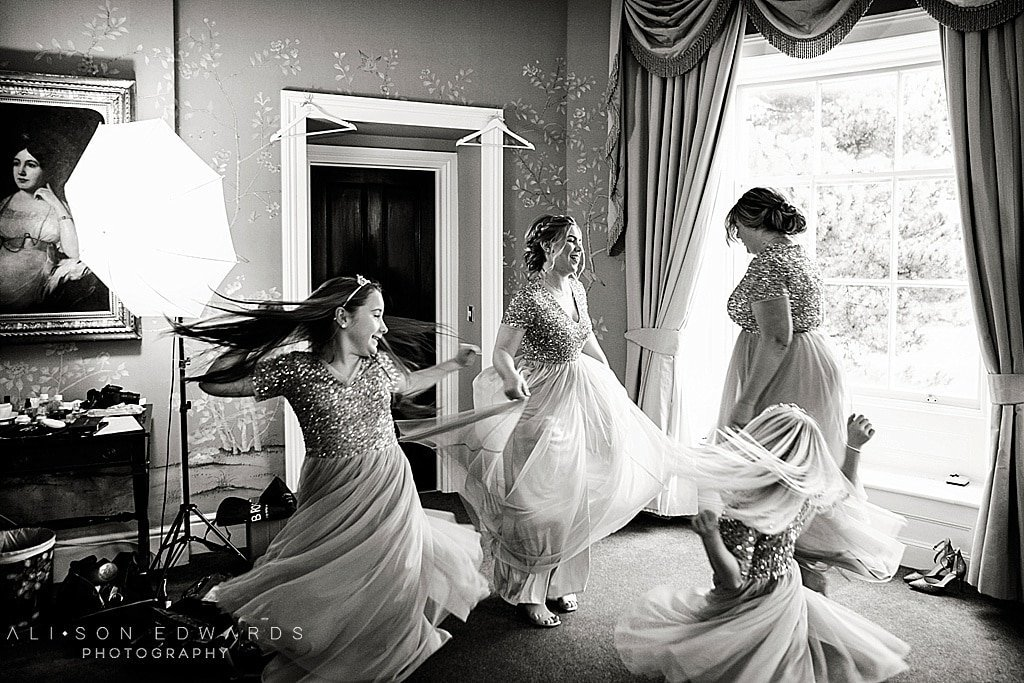 bridesmaids dancing in dresses at stubton hall wedding photographer