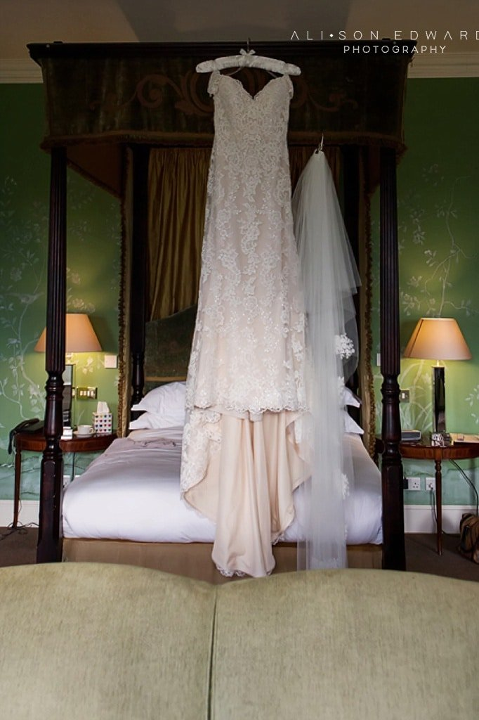 wedding dress on four poster bed at stubton hall