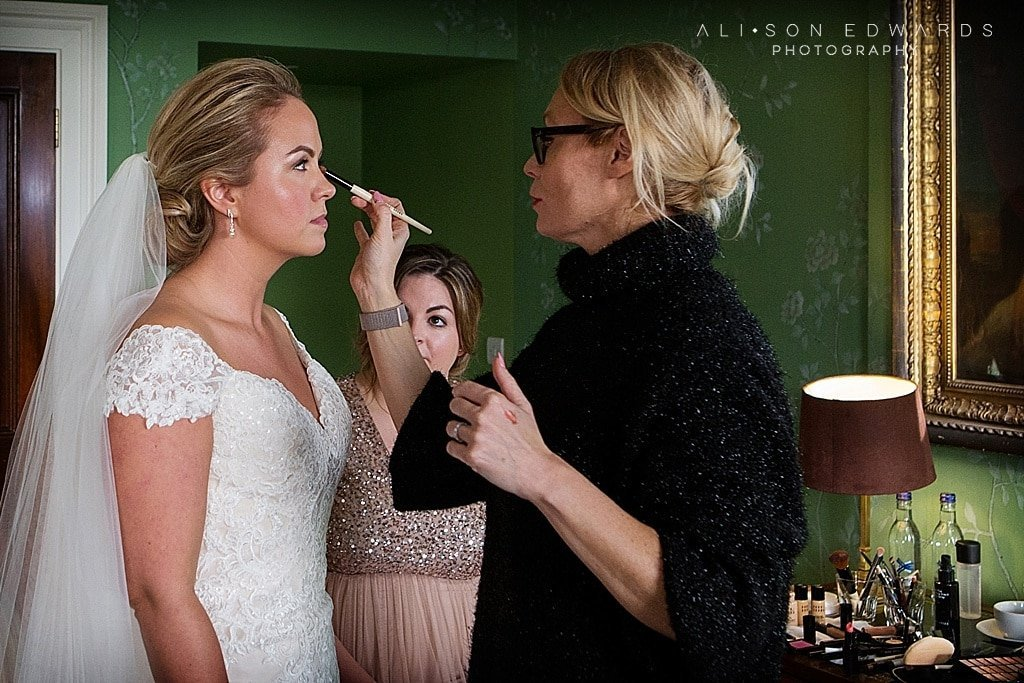 bride having finishing touches to make-up