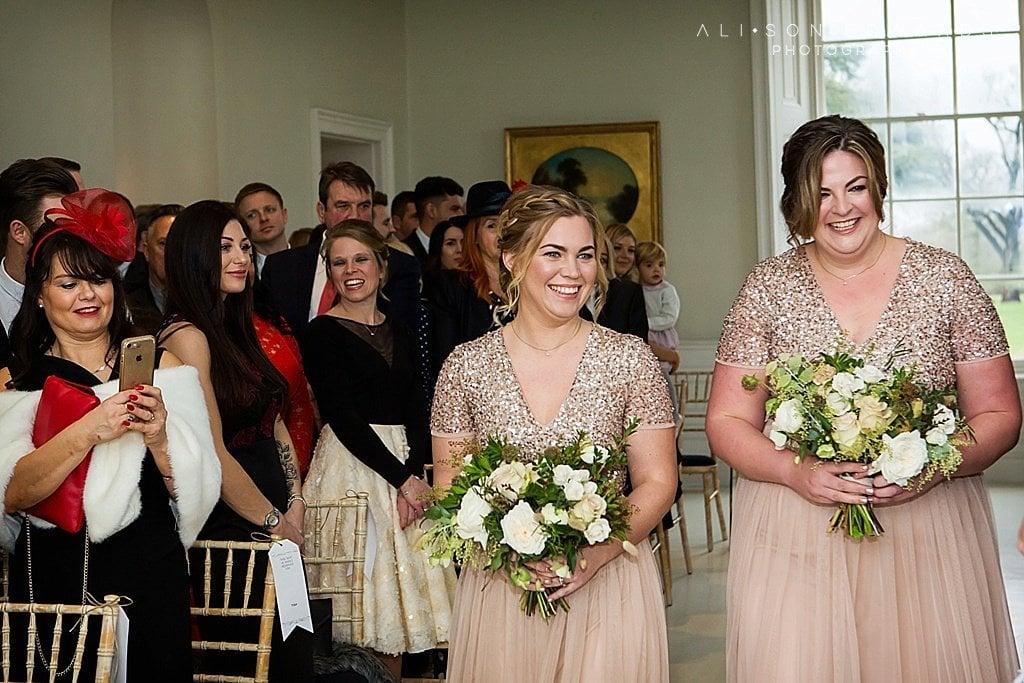 2 bridesmaids walking down aisle at stubton Hall