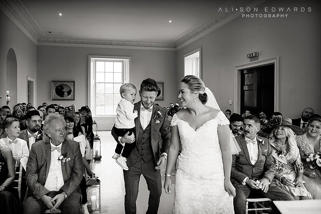 bride and groom with son at stubton hall