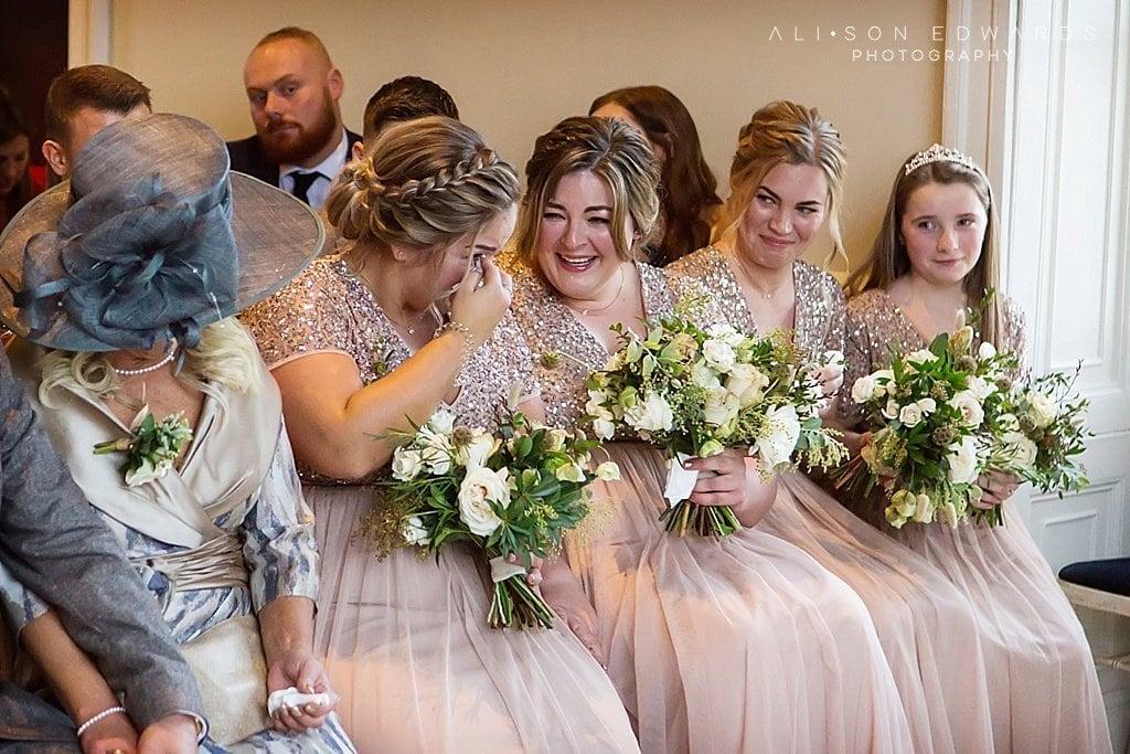 bridesmaids wiping tears at stubton hall