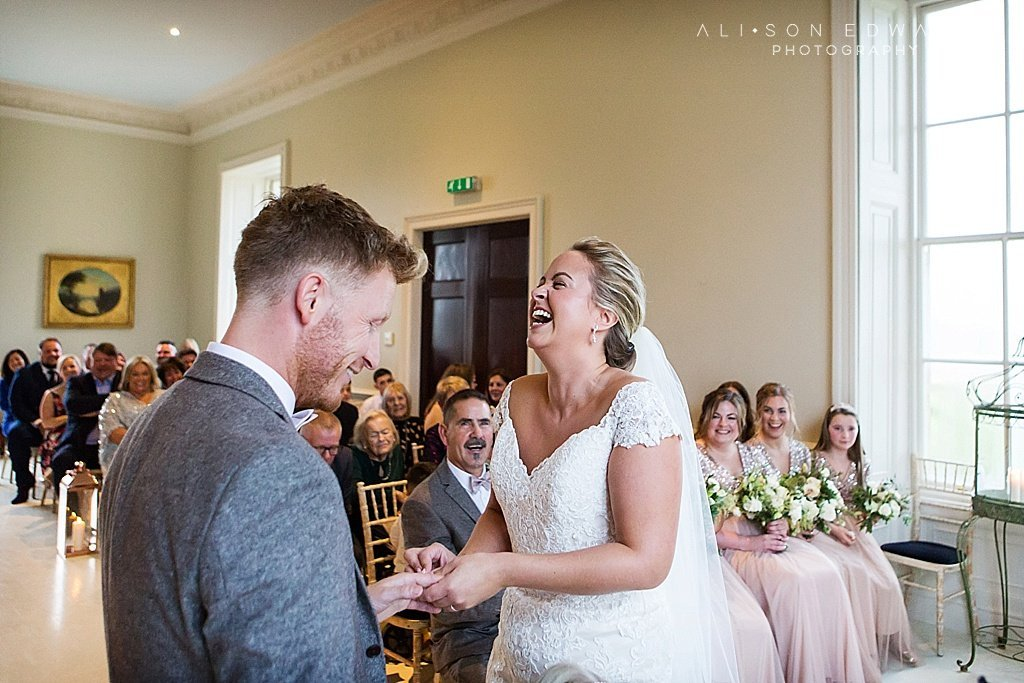 bride and groom laughing in ceremony at stubton hall wedding photographer
