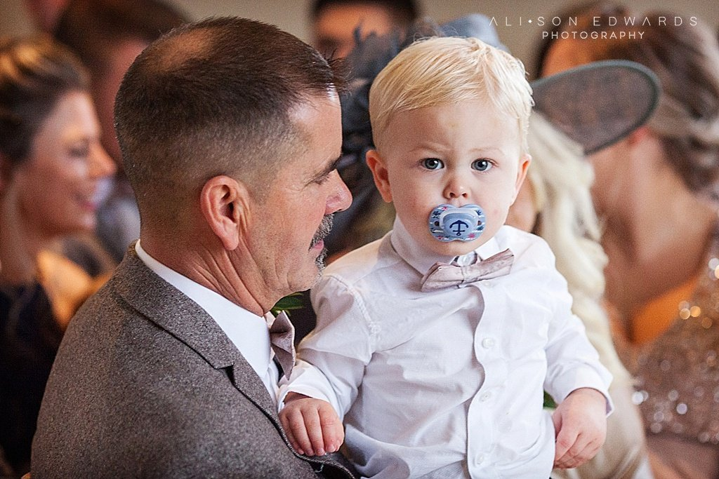 dad and grandson in ceremony at stubton hall
