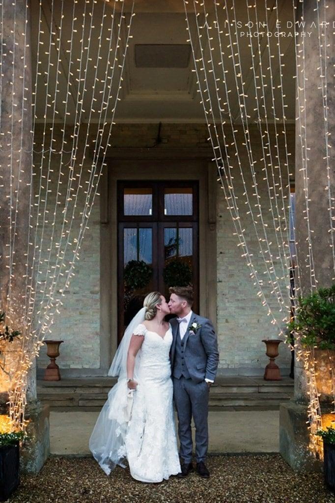 bride and groom kissing at stubton hall