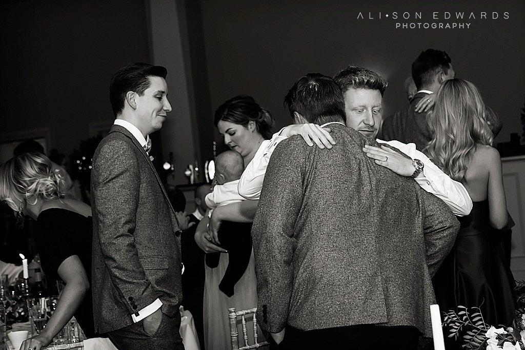groom hugging best man after speeches