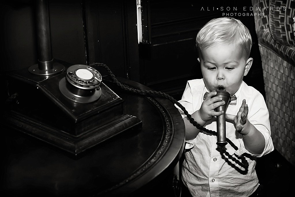 boy playing with old telephone