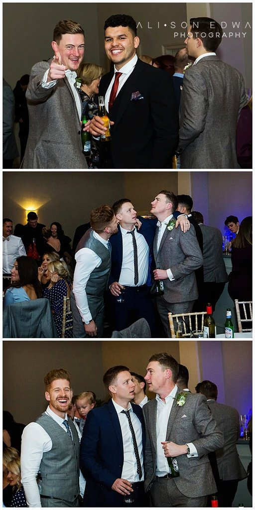 men joking around at stubton hall wedding reception