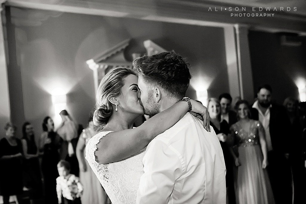 bride and groom kissing in first dance