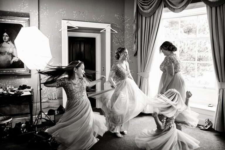 bridesmaids spinning around in dresses at stubton hall