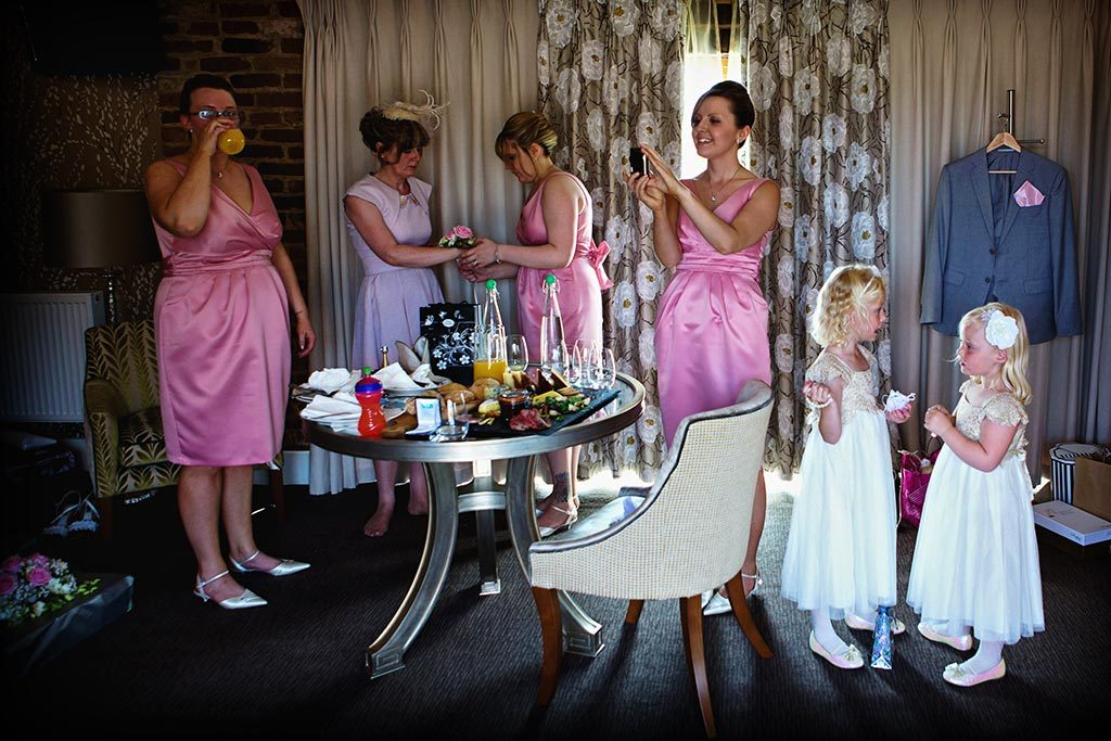 wedding photography of bridesmaids getting ready at Mythe Barn