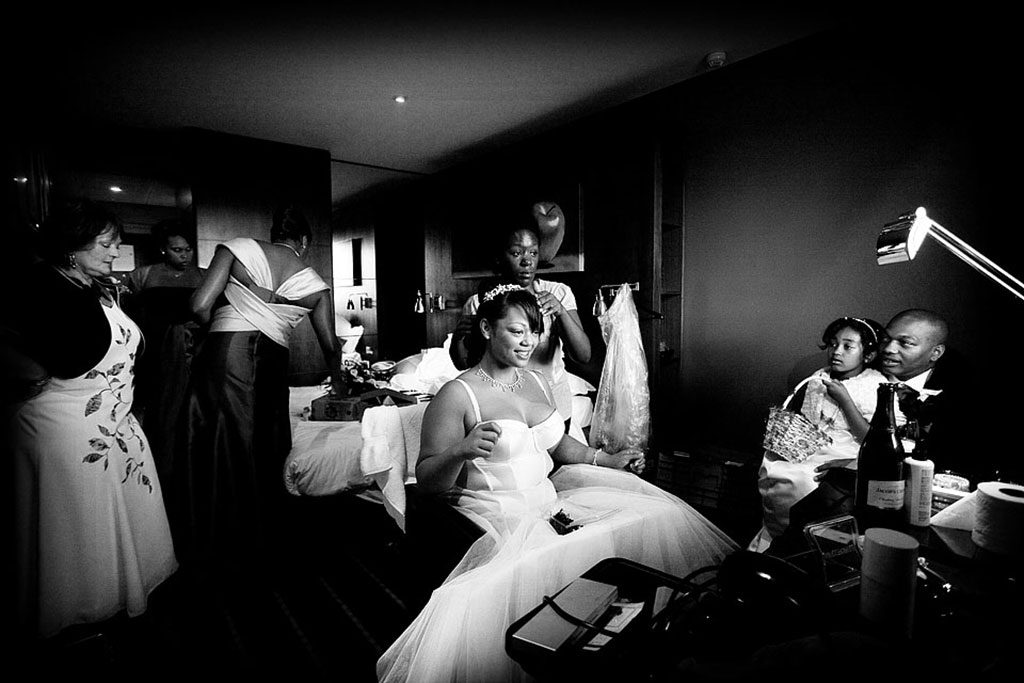 bride getting read with family in hotel room in Nottingham