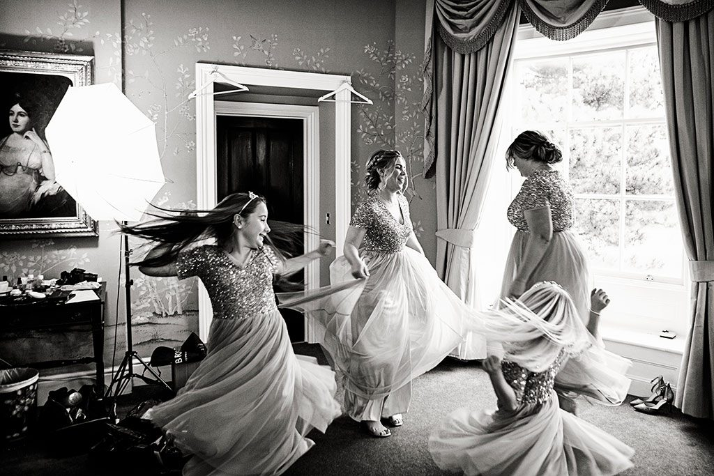 bridesmaids dancing in dresses at Stubton Hall