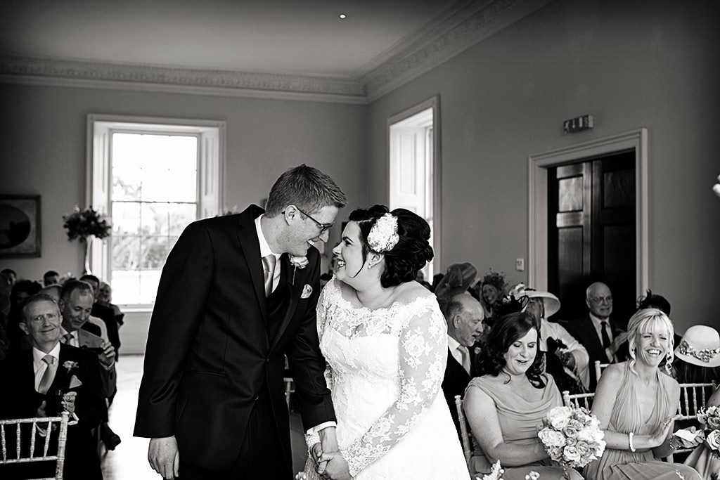 bride and groom smiling at alter at Stubton Hall, Nottingham