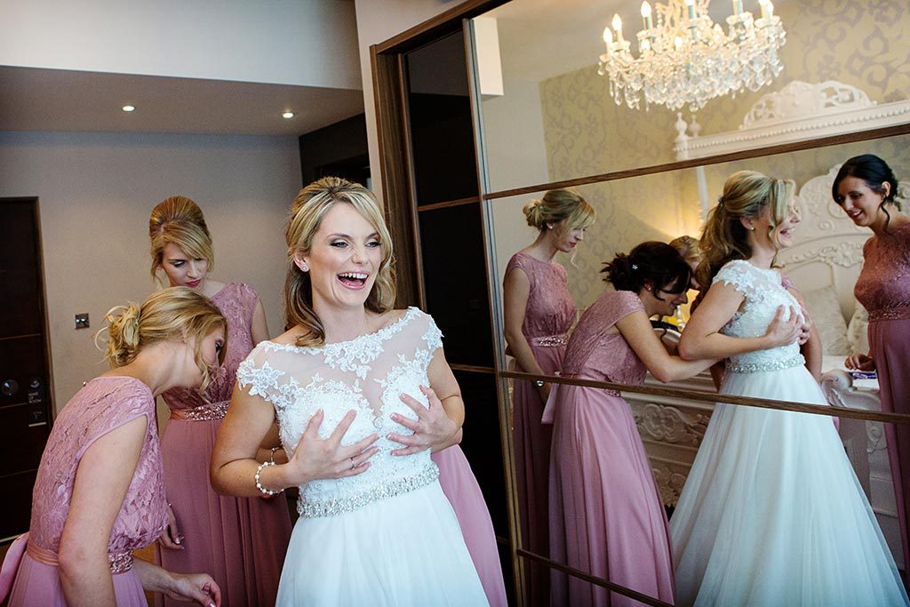 bride laughing holding onto wedding dress at old vicarage boutique hotel