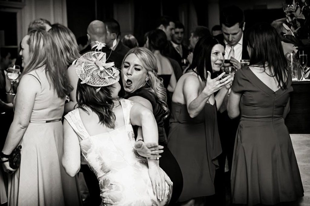 wedding photography of guests laughing