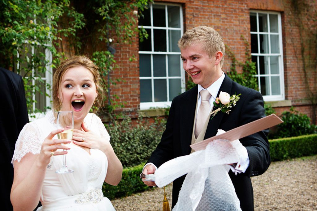 bride looking shocked at champagne sword at norwood park