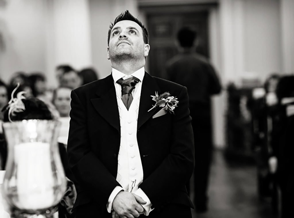 groom waiting nervously for bride at Colwick Hall