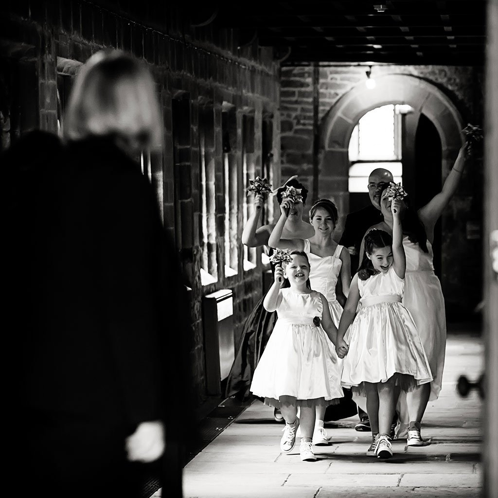 bride and bridesmaids cheering walking to ceremony at Newstead Abbey