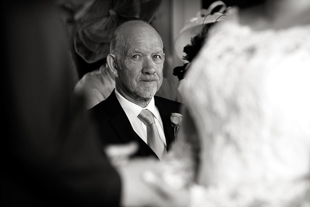 groom looking at bride exchanging vows at Stubton Hall