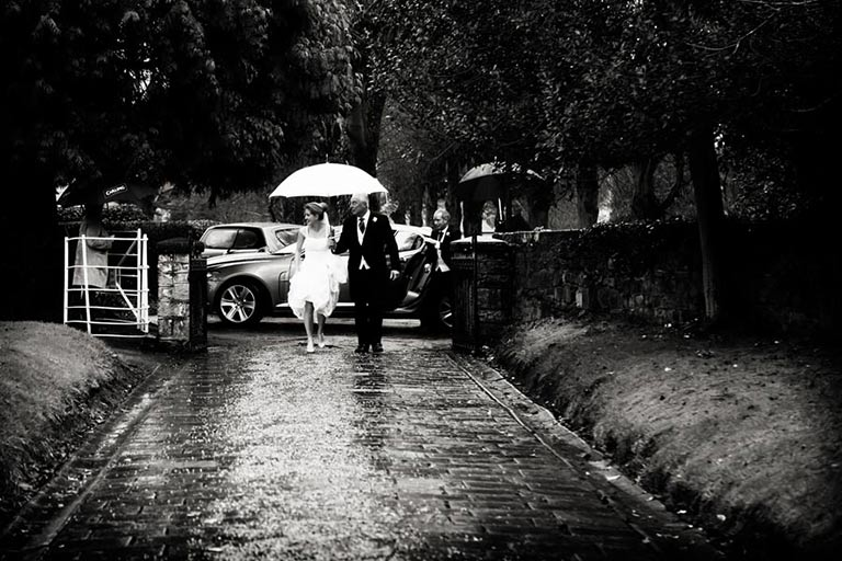 bride walking in rain to church in Burton on Trent