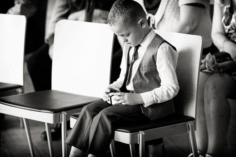 boy looking at rings before wedding ceremony at Newstead Abbey