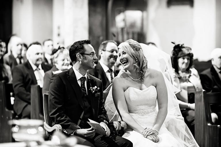 bride and groom laughing during ceremony at st. barnabus cathedral