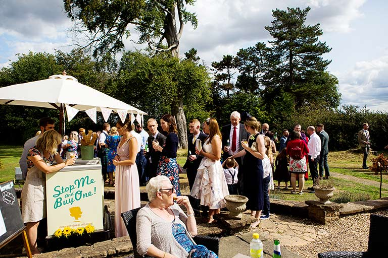 wedding photography of guests eating ice-cream at cockcliffe country house