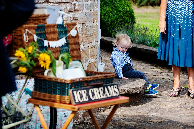 boy sitting on steps near ice-cream at cockcliffe country house