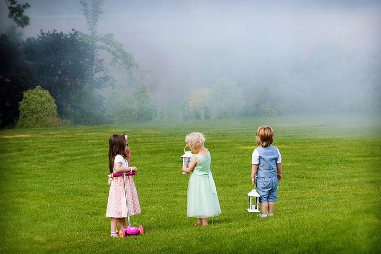 young children looking over at smoke at nottingham wedding