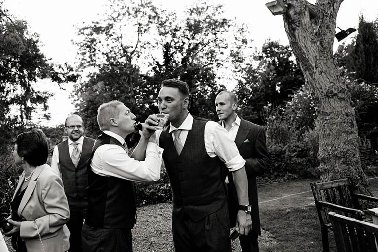 men drinking at vale of belvoir wedding